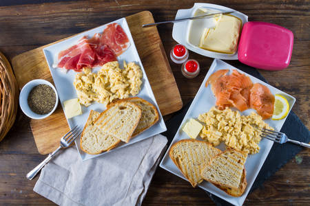 scrambled eggs: Delicious breakfast: scrambled eggs, toasted bread, salmon and ham.