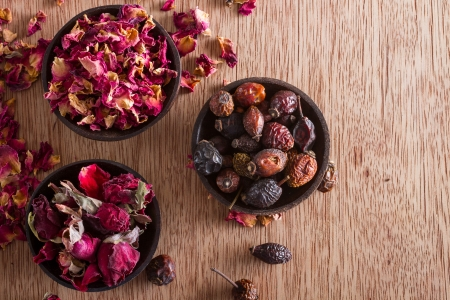 Dried rose hips, buds and petals: for tea, alternative medicine, pot-pourri. Copy space. Stock Photo