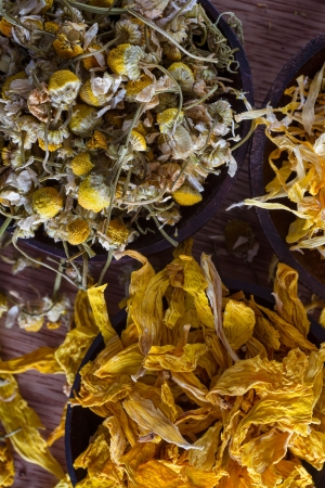 Dried marigold and sunflower petals, and chamomile buds: for herbal tea, alternative medicine, pot-pourri. photo