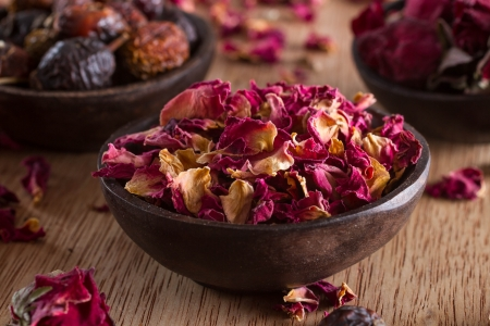 Dried rose petals: for tea, alternative medicine, pot-pourri. Copy space. Stock Photo