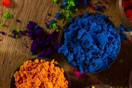complementary: Colorful, finely powdered Indian pigments. Complementary colours: blue and orange. Stock Photo
