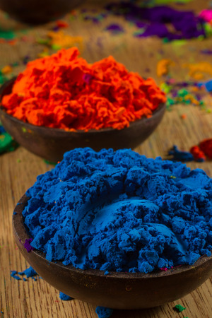 complementary: Colorful, finely powdered Indian pigments. Complementary colours: blue and orange. Focus on blue. Stock Photo