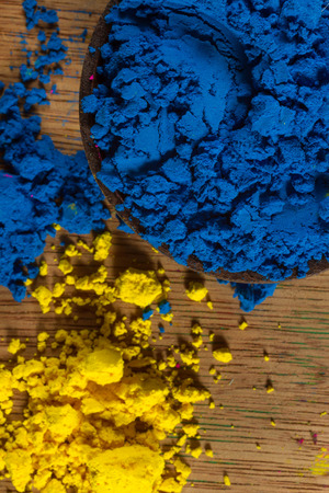 complementary: Colorful, finely powdered Indian pigments. Complementary colours: blue and yellow. Focus on blue. Stock Photo