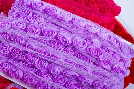 purple silk: Pretty ribbons with rose patterns in a light mesh material.g