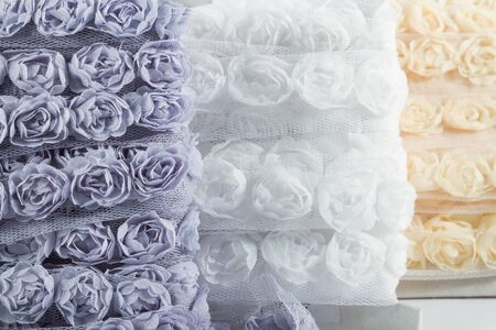organza: Pretty ribbons with rose patterns in a light mesh material.