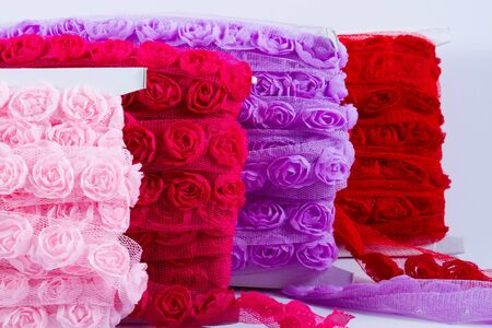 Pretty ribbons with rose patterns in a light mesh material. photo