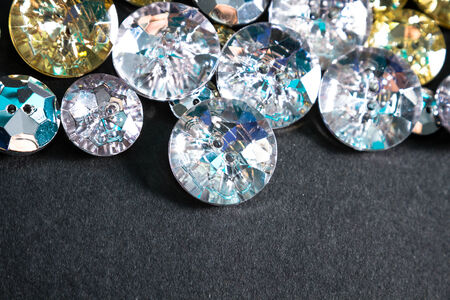 affordable: Buttons shaped like fake diamonds, for affordable glamour. Stock Photo