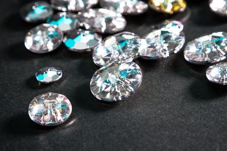 fake diamond: Buttons shaped like fake diamonds, for affordable glamour. Stock Photo