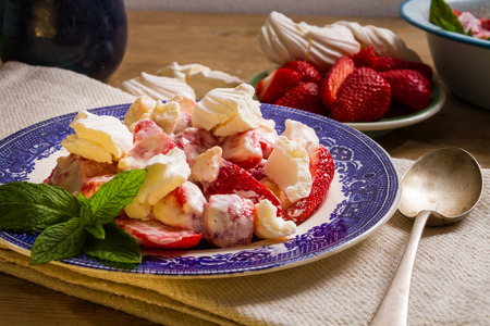 eton mess: Typical English summer dessert: Eton mess, made with strawberries (or other fruit), crushed meringue and whipped cream.