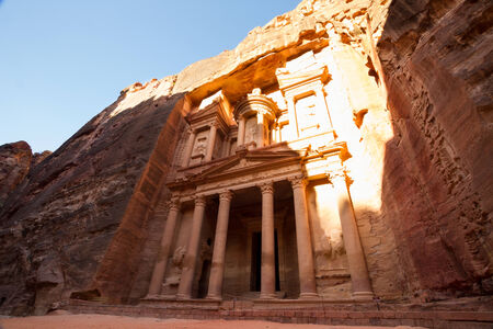 reached: Facade of the Treasury, one of the main monuments in Petra, Jordan, reached after a long walk through a canyon (called siq).