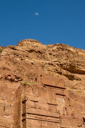 siq: The moon rises over the ruins of Petra, Jordan.