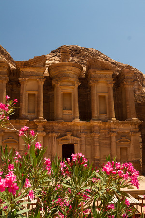 horse cart: Oleander bush and the facade of the Monastery, one of the famous monuments of the ancient Nabatean city of Petra, Jordan. Stock Photo