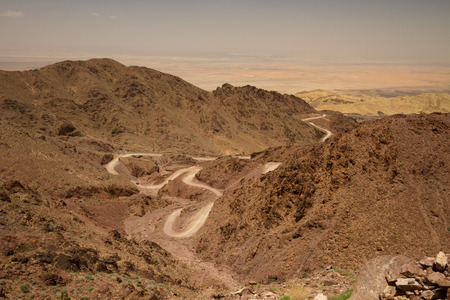 Wadi: View of Wadi Araba towards the Dead Sea, with the dirt road winding down the hill.
