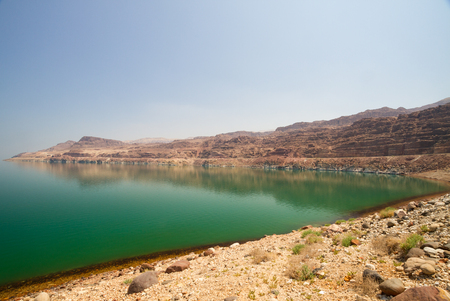 land locked: The green water of the land-locked Dead Sea in Jordan, by the entrance to Wadi Mujib, on the Jordan side.