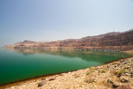 landlocked: The green water of the land-locked Dead Sea in Jordan, by the entrance to Wadi Mujib, on the Jordan side.