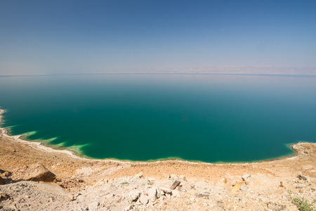 dead sea: The vast, green expanse of the waters of the land-locked Dead Sea in Jordan, with a view to the Israeli side.