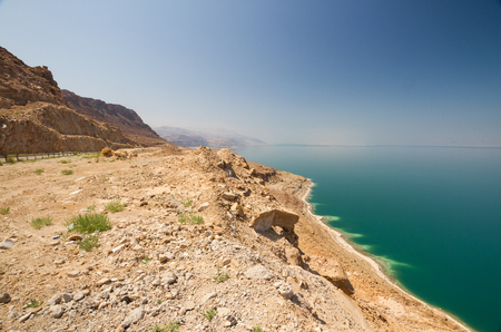 land locked: The green water of the land-locked Dead Sea in Jordan, with a view to the Israeli side. Stock Photo
