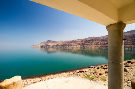 The green waters of the land-locked Dead Sea in Jordan from a cottage by the entrance to Wadi Mujib, on the Jordan side.