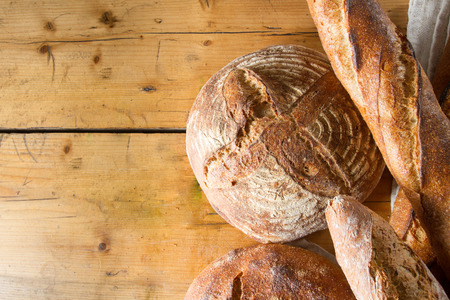 A delicious loaf of sourdough bread and baguettes, fresh out of the oven. Stock Photo
