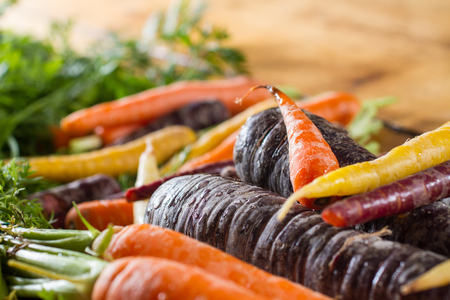 Multi-coloured organic fresh carrots. Healthy vegetarian vegan eating.