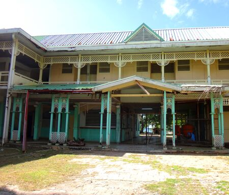 moorea: Abandoned hotel at the port of Paopao in Cooks Bay, Moorea, French Polynesia. Stock Photo