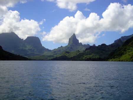 polynesia: View of Moorea from the lagoon on a cruise ship, French Polynesia. Stock Photo