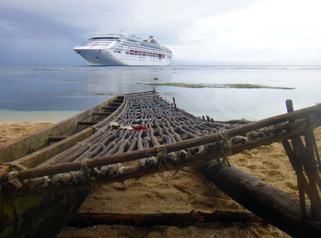 Cruise ship from the beach of Kiriwina Island, Papua New Guinea.