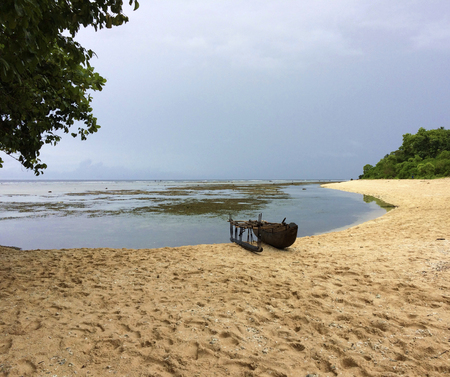 Canoe on the beach in Kiriwina, Papua New Guinea. Stock Photo