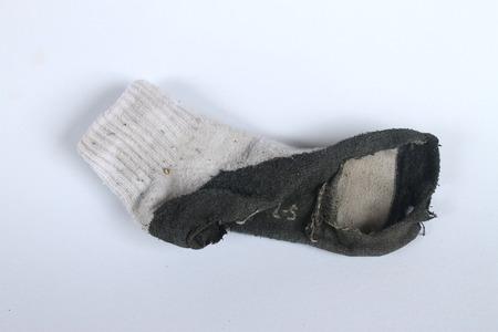 Old white sock break through.Kids Old sock. Banco de Imagens