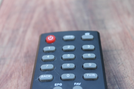 tv remote control on wooden table