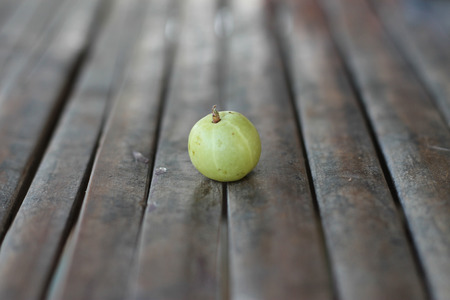 Indian Gooseberry  on bamboo table Archivio Fotografico