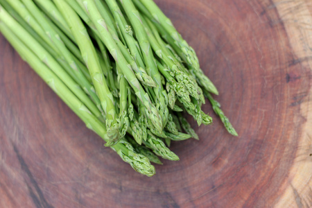 Raw asparagus. Fresh Asparagus on wooden background Stock fotó