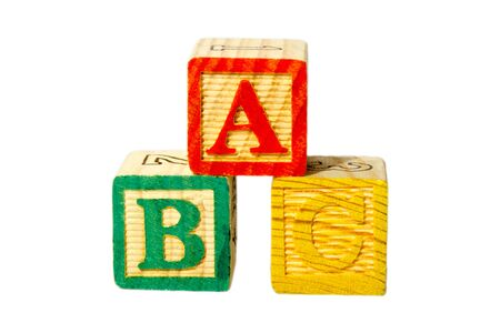 A, B and C wooden alphabet block isolate on a white background called ABCs blocks uses for play in preschool as a toy.