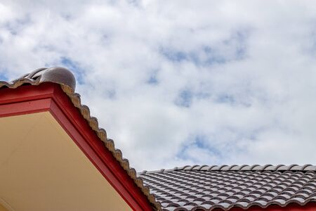The gable roof with the sky with clouds background. 版權商用圖片