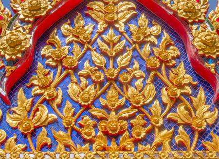 the fascinating Thai design on top of the monastery   photo