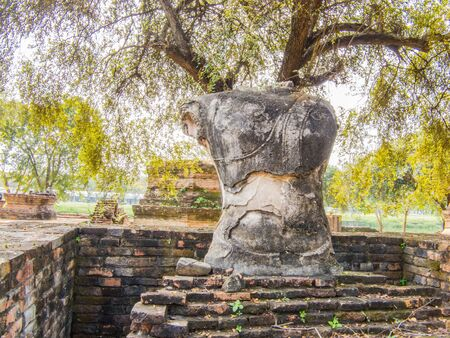 a ruined Buddha Image  in a temple in Ayutthaya Province , Thailand. Stock Photo - 17549350