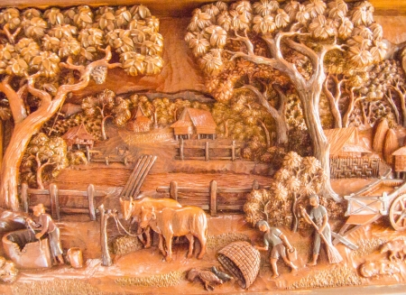 rural area: The carved teak wood shows the daily life in Thai rural area