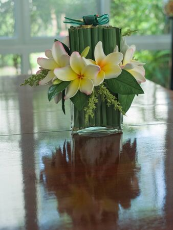 liesure: Yellow - red flowers and green pieces of wood on the table  Stock Photo
