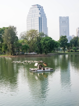 public transfer: An aerator for water treatment in a lake of city public park. Stock Photo