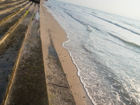 Concrete steps and soft sand beach  Stock Photo