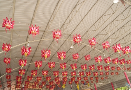 beliefs: Chinese lanterns are decorated in front of a house with sacred beliefs of prosperity and wealth