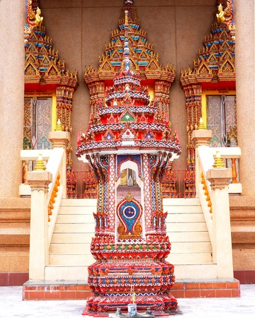 demarcation:  Arched paraphet is the pinnacle that is a demarcation of temple zone  in Buddhist monastery     This colorful one is located in front of the chapel
