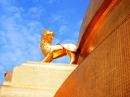 A golden lion statue represents the country around Thailand standing at a corner of Phra Maha Chedi in Wat Bovornnives , Bangkok , Thailand Stock Photo - 21428983