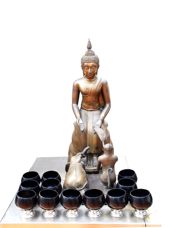 The Buddha sitting on the stone block    Left hand down on the left knee, the right one on the right knee  The  Elephant and the  monkey  are waiting                                                              Stock Photo