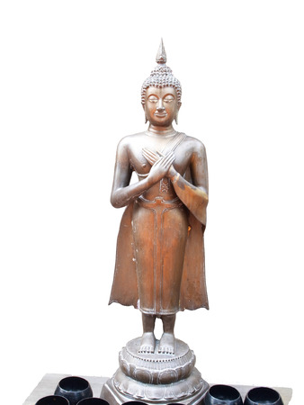 The Buddha stands  raising both of his hands folded on his chest , the right hand over the left