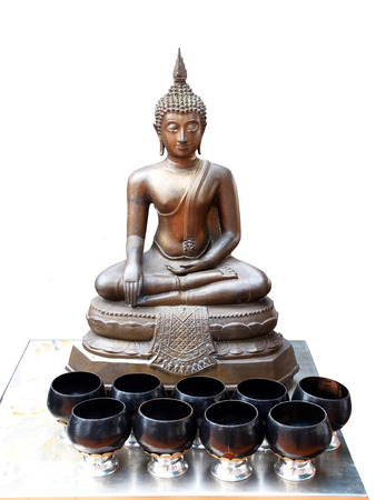 squat:  The Buddha in the squat posture ,Placed the left hand on the thighs and the right one upside down at the knees                                                                Stock Photo