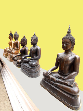 A row of buddha statues on isolated background