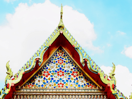Triangular decorative gable on top of the temple in buddhism monastery