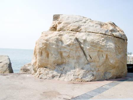 sandbank: Grand rocks stand on sandbank against wind and sea water