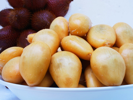 Light yellow flesh of salacca , a tropical fruit that has sweet and sour flavor